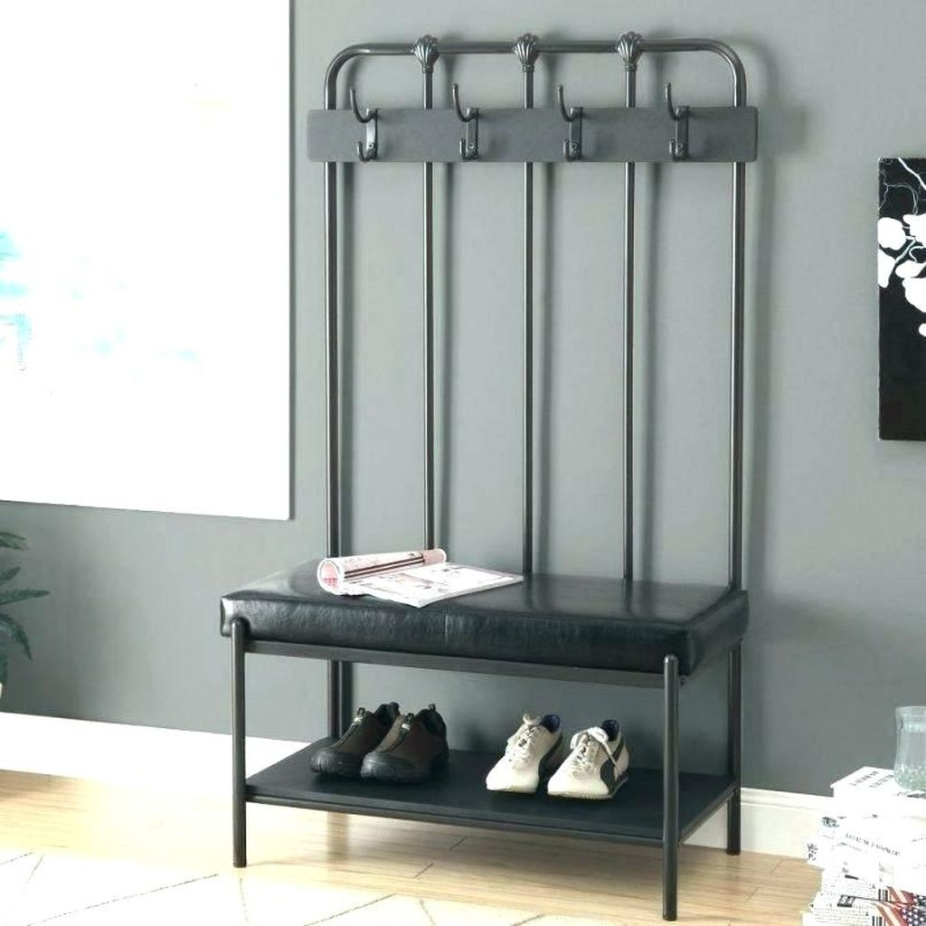 An awesome entryway hooks combined with storage benches to perfect your modern entryway