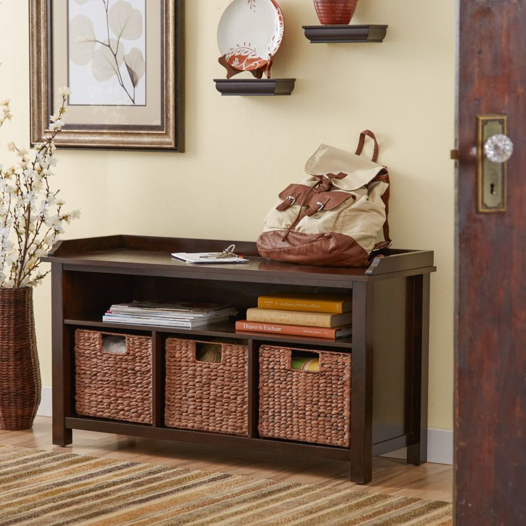 Classic wooden storage bench with storage basket below it and shelves book to complete your entryway decor