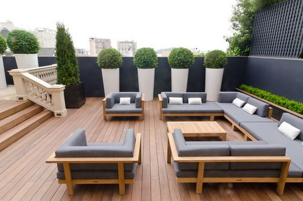 Modern rooftop garden design with grey sofa combined with wooden floor to beautify your rooftop garden design