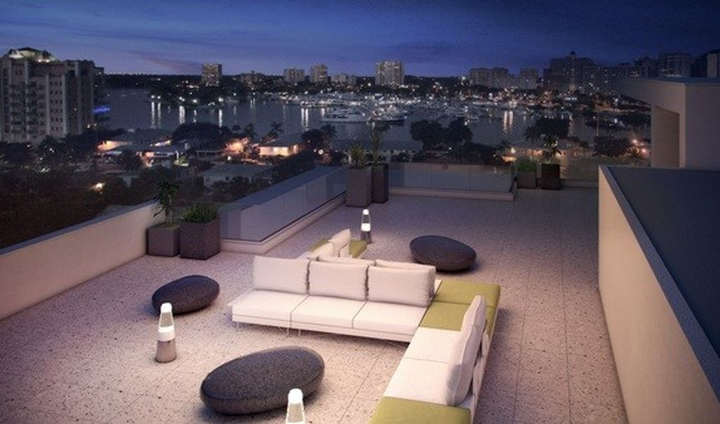 Modern small rooftop lighting with led lights combined an elegant sofas and unique table to perfect your rooftop design