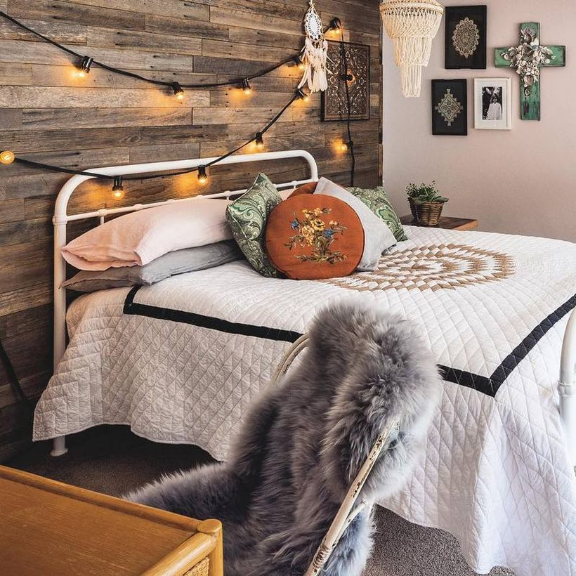 Simple boho bedroom style with white blanket pattern simple, white and gray pillows, wooden walls are equipped with string lamps to look creative decoration