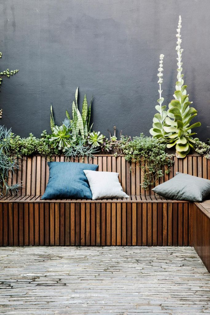 Wooden bench combined with plants and cushion