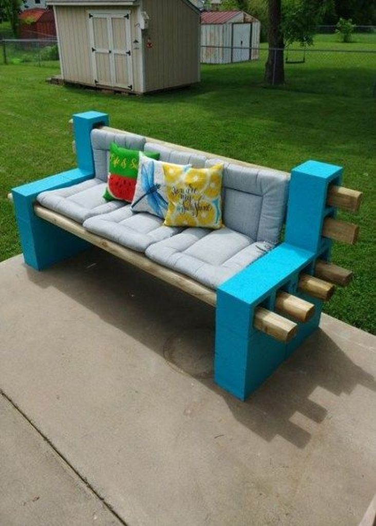 Wooden bench with patterned cushion