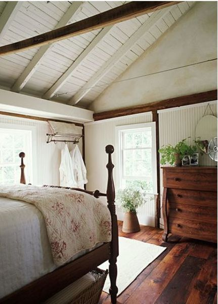 A-white-wooden-ceiling-plus-beams-stained-wooden-furniture.-1