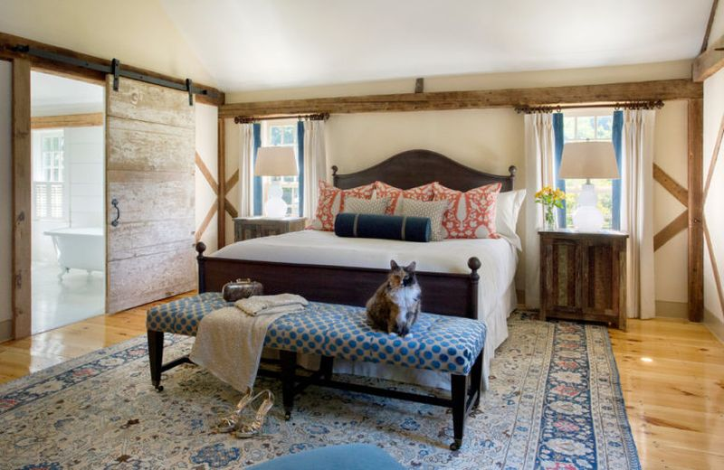 Farmhouse-bedroom-with-much-weathered-and-aged-wood-traditional-textiles.-1