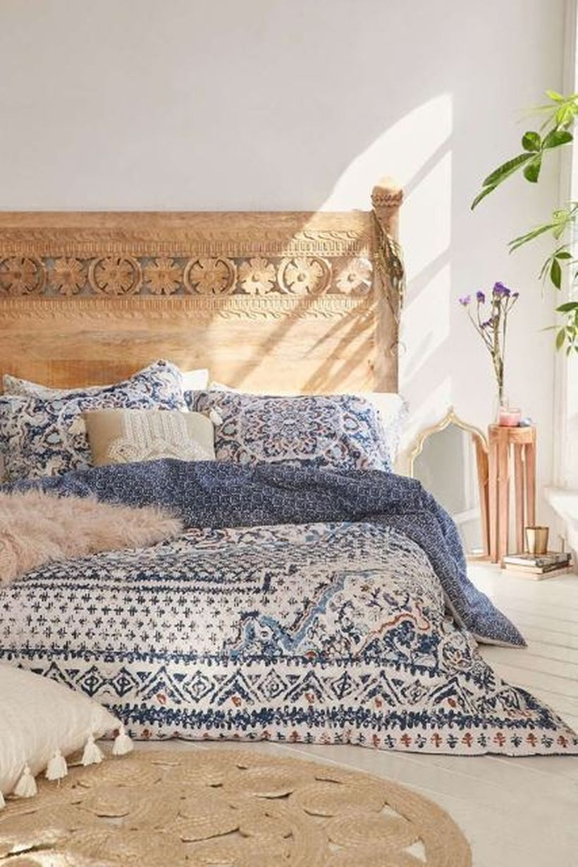 Unique-carved-wooden-backdrop-bed-and-small-night-stand-to-compliment-your-room-furniture-by-adding-unique-bed-linen-patterns-for-a-boho-style-touch