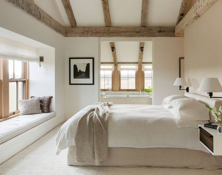 Weathered-wood-ceiling-beams-neutral-textiles-and-much-natural-light.-1
