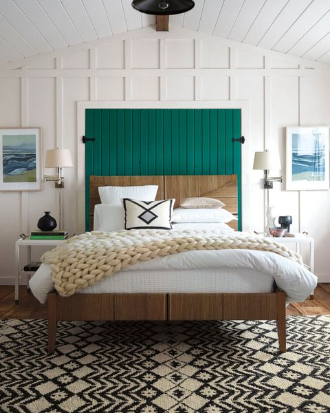 White-wooden-panels-a-bright-emerald-headboard-a-printed-rug.-1
