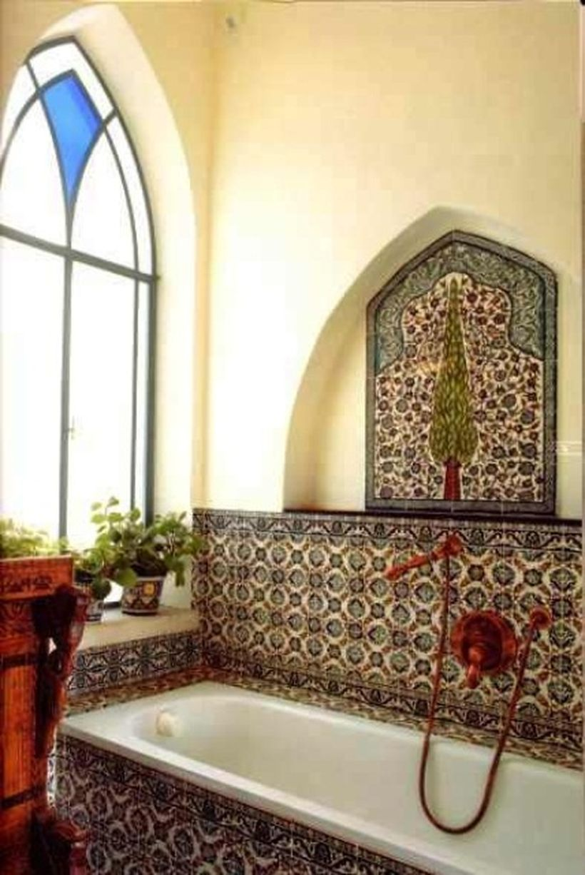 Unique-bathtub-with-a-boho-style-pattern-that-matches-the-wall-for-your-bathroom