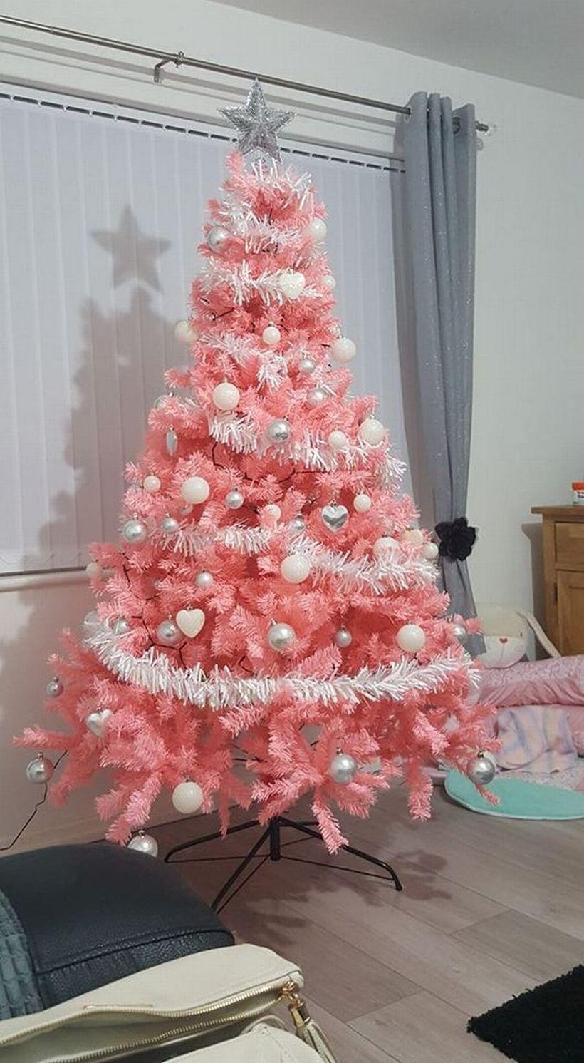 Pink chrismast tree combine with white ornament and white ribbon