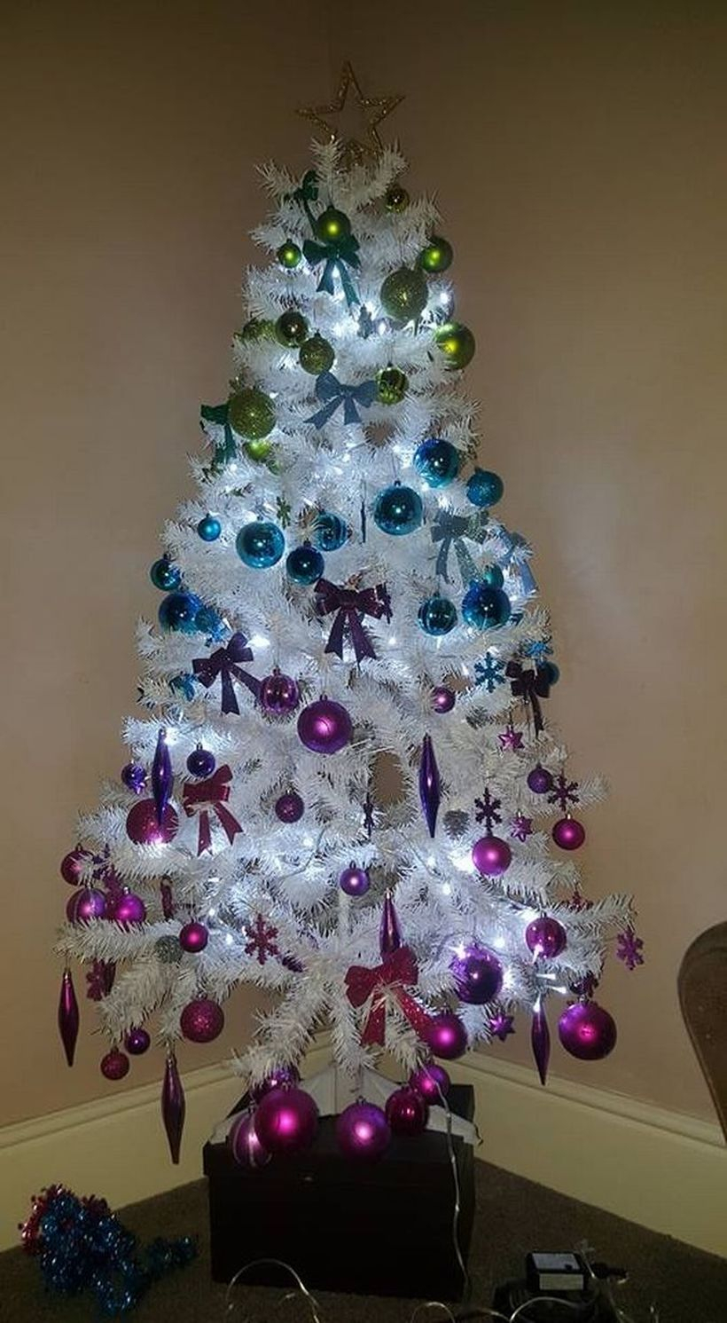 Small chrismast tree with colorful ornament and white light