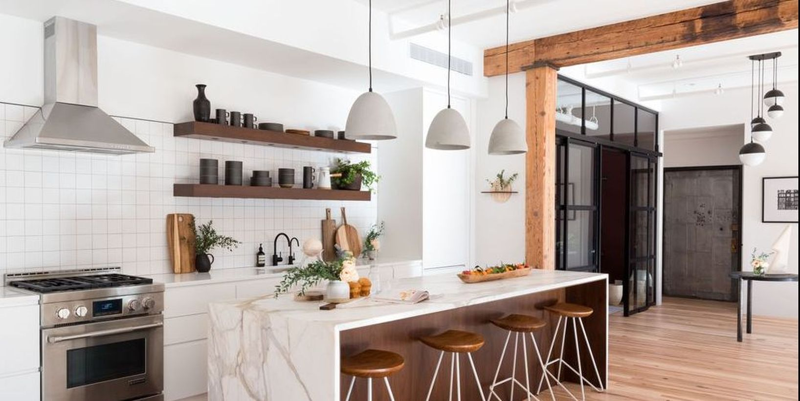 1a-trio-of-concrete-gray-pendants-softly-grounds-a-white-and-wood-kitchen.