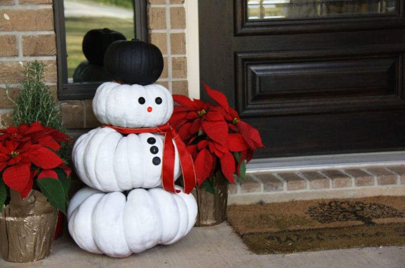 A-trio-of-mini-pumpkins-becomes-a-snowman-who-can-welcome-guests-to-your-home-minus-the-freezing-winter-temps.