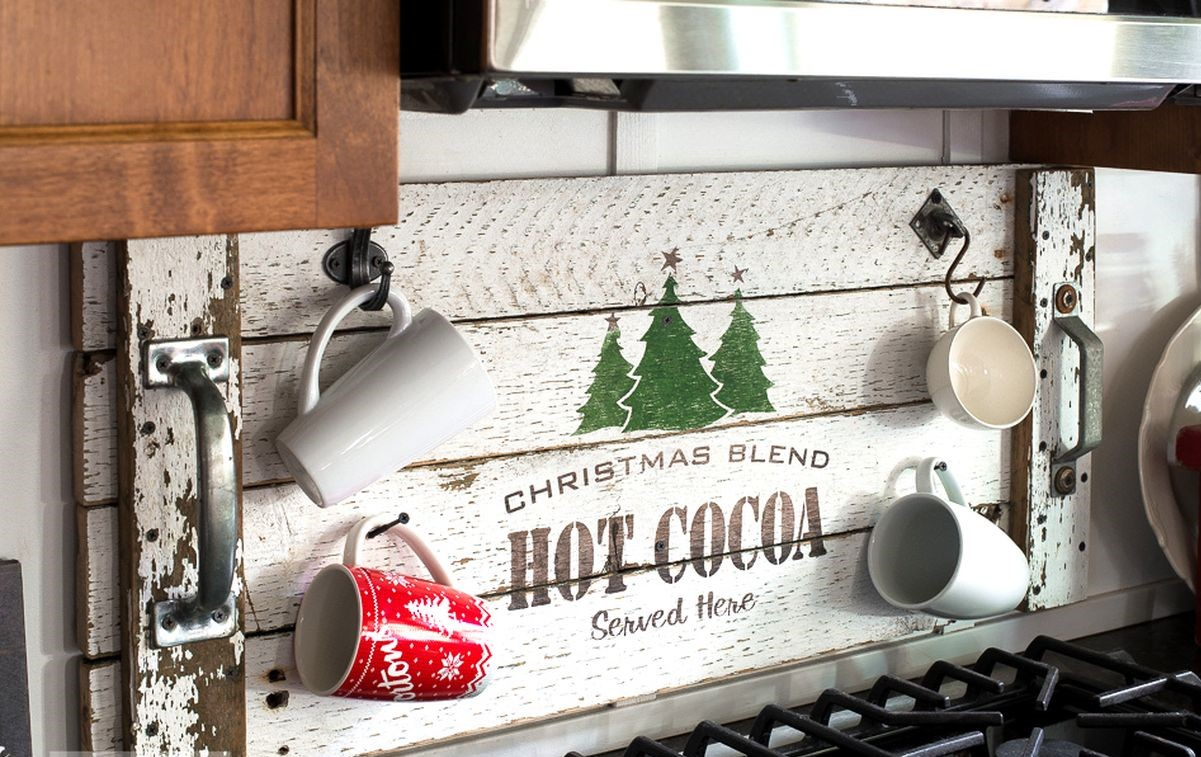 Think-easy-like-hanging-up-a-hot-cocoa-christmas-tray-and-turning-it-into-a-festive-cup-holder-behind-the-stove.-1
