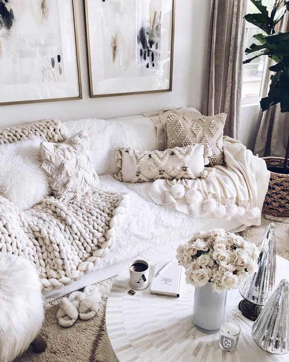Lots-of-fringe-and-beaded-pillows-and-a-chunky-knit-blanket-make-the-living-room-amazingly-cozy-and-wlecoming